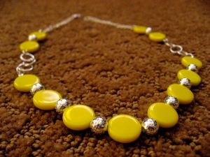 A more detailed view of the yellow necklace.