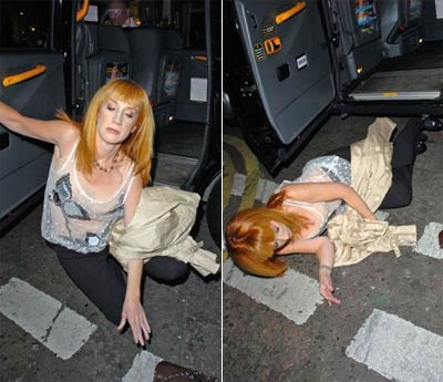 Attention whore, Kathy Griffin staging an awesome photo op.