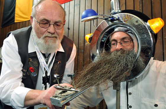 A man's beard is measured during the International German Beard Championships in Schluchsee, Germany.